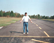 Larry points out Tom's skidmarks where he brought his CE206 cargo plane down on the model aircraft runway. Click for a larger image.